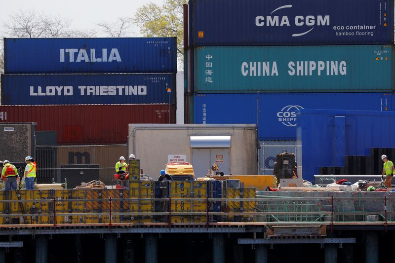 Shipping containers are stacked at the Paul W. Conley Container Terminal in Boston