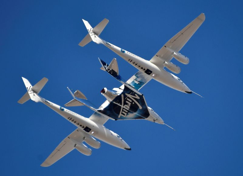 FILE PHOTO: Virgin Galactic rocket plane, the WhiteKnightTwo carrier airplane, with SpaceShipTwo passenger craft takes off from Mojave Air and Space Port
