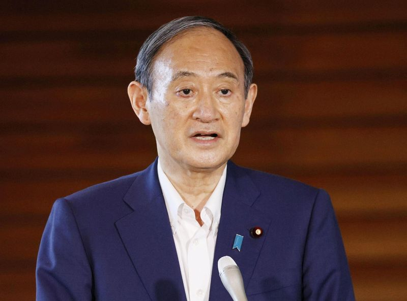 Japan's Prime Minister Yoshihide Suga speaks to media after he annouced to pull out of a party leadership race at his official residence in Tokyo