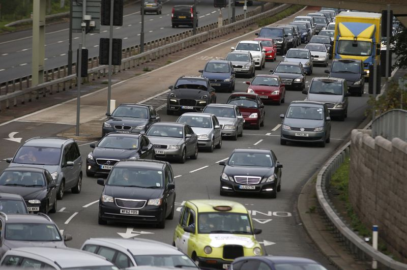 FILE PHOTO: A traffic jam is seen as cars head towards the approach tunnel of Heathrow Airport, west London