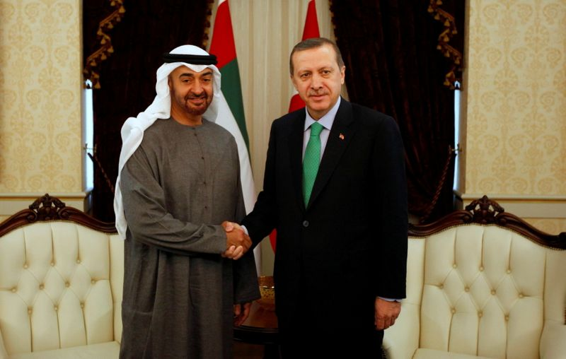FILE PHOTO: Abu Dhabi's Crown Prince Sheikh Mohammed shakes hands with Turkey's PM Erdogan before a 2012 meeting in Ankara