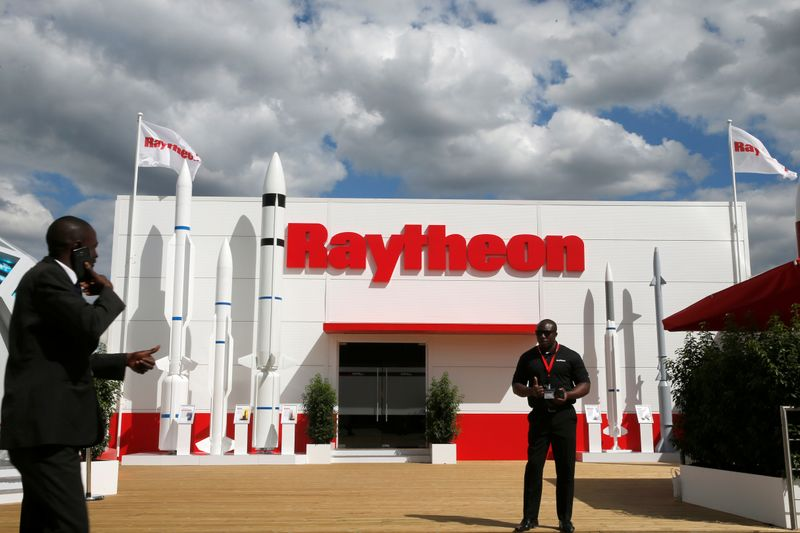 A security officer stands guard in front of a Raytheon stand at the 53rd International Paris Air Show at Le Bourget Airport near Paris