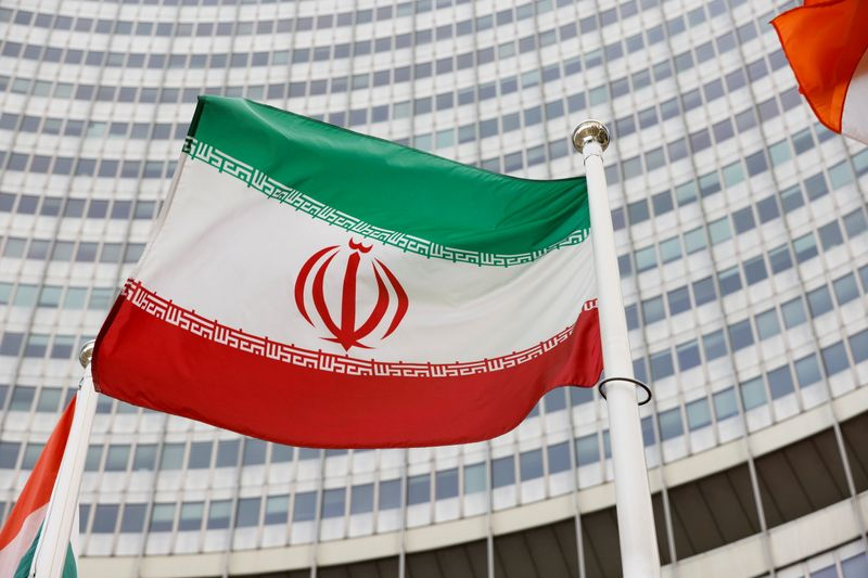 FILE PHOTO: The Iranian flag waves in front of the International Atomic Energy Agency (IAEA) headquarters, in Vienna