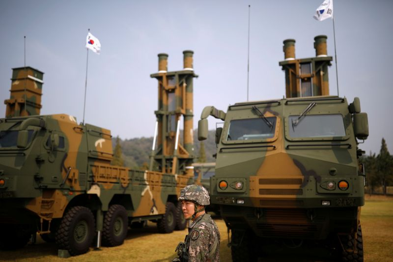 FILE PHOTO: A South Korean soldier walks past Hyunmoo-2 and Hyunmoo-3 ballistic missiles during a photo opportunity ahead of a celebration to mark the 69th anniversary of Korea Armed Forces Day, in Pyeongtaek