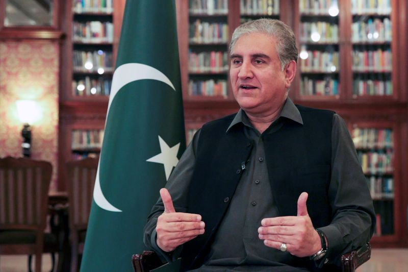 Pakistan's Foreign Minister Shah Mehmood Qureshi gestures as he speaks during an interview with Reuters at the Ministry of Foreign Affairs office in Islamabad