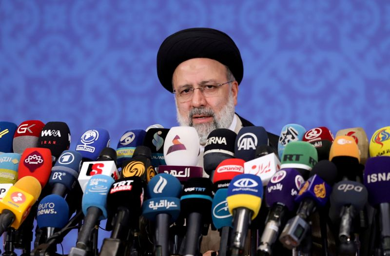 FILE PHOTO: Iran's Ebrahim Raisi speaks during a news conference in Tehran