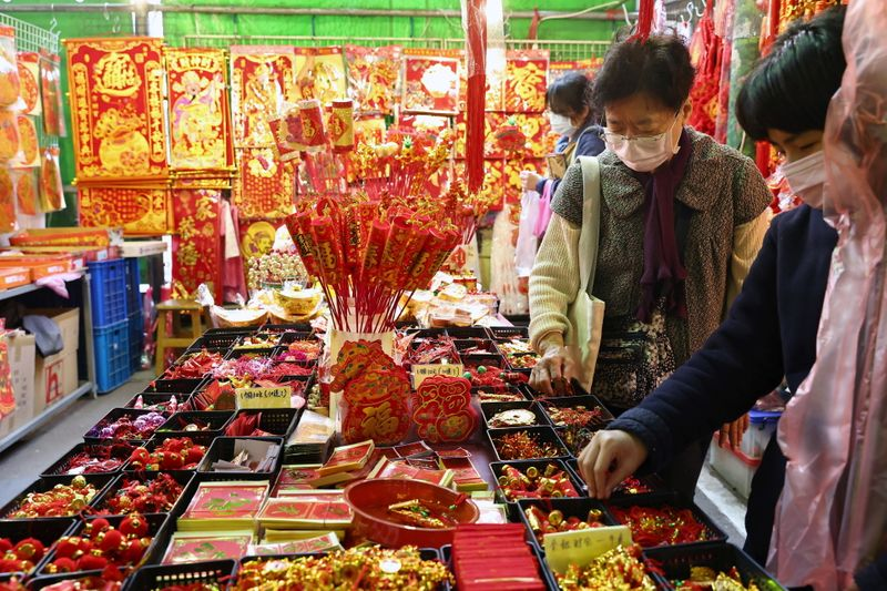 People buy New Year decorations ahead of the Lunar New Year holiday in Taipei