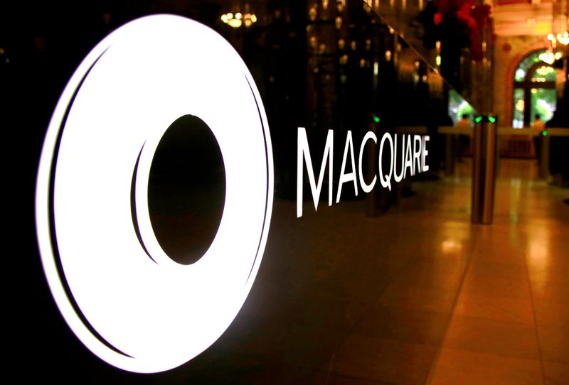 FILE PHOTO: FILE PHOTO: The logo of Australia's Macquarie Group adorns a desk in the reception area of its Sydney office headquarters