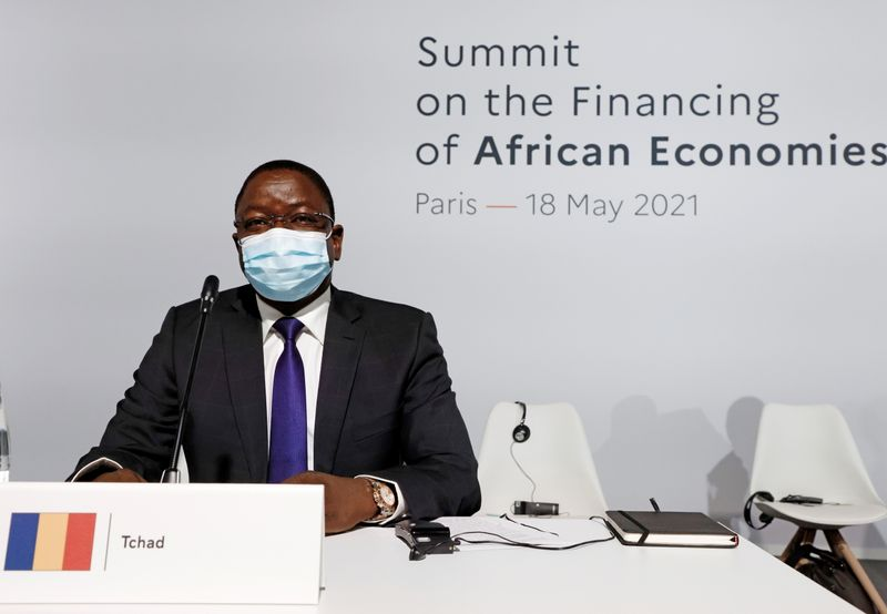 FILE PHOTO: Chad's Prime Minister Albert Pahimi Padacke poses before the opening session of the Summit on the Financing of African Economies in Paris, France May 18