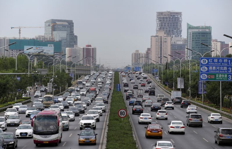 FILE PHOTO: Cars drive on the road during the morning rush hour in Beijing