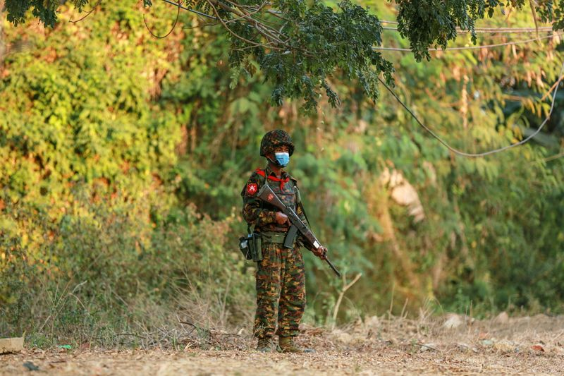 FILE PHOTO: A Myanmar soldier stands guard near the Congress compound in Naipitaw, Myanmar