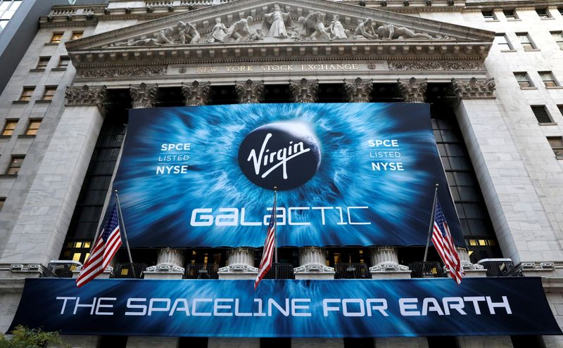FILE PHOTO: A banner hangs on the outside of the New York Stock Exchange (NYSE) ahead of Virgin Galactic (SPCE) IPO in New York