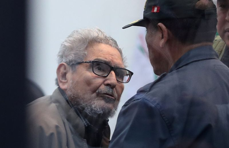 Shining Path founder Abimel Guzmán attends a trial at a high security naval prison in Callao, in Miraflores, during the sentencing of the 1992 Shining Path car bomb case