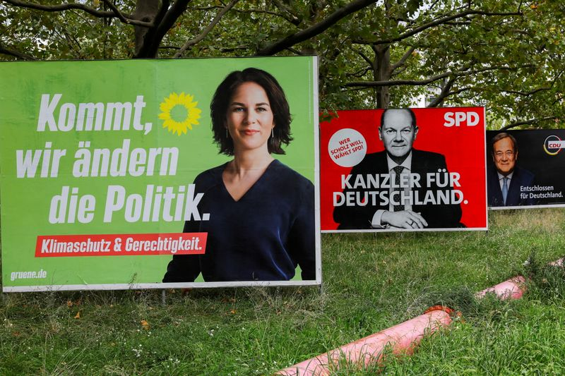 FILE PHOTO: Top candidates for German chancellor feature on campaign billboards