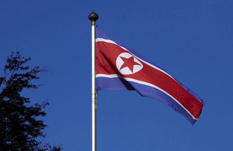 FILE PHOTO - A North Korean flag flies over a mast at the Permanent Mission of North Korea in Geneva