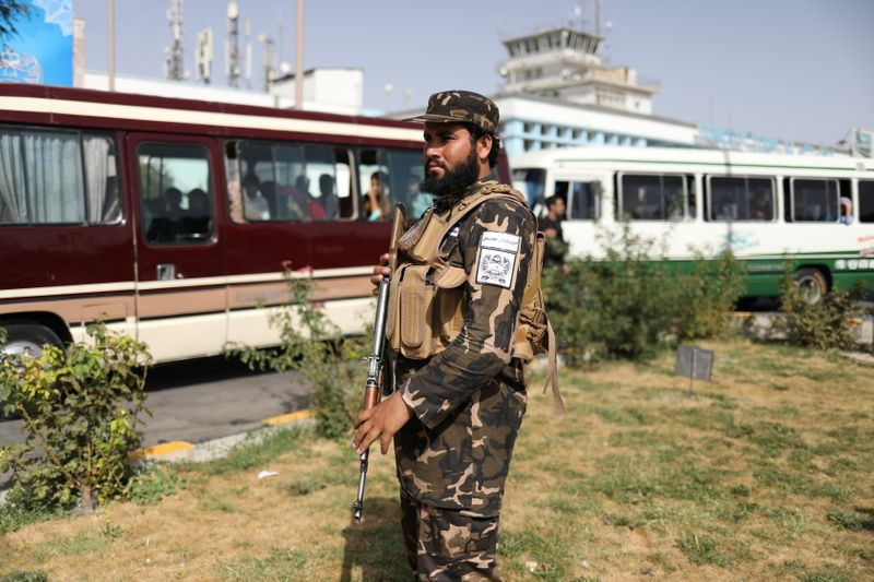 A member of Taliban security forces guards the international airport in Kabul