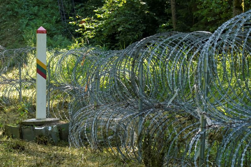 Lithuania toughens Belarus border with razor wire to bar migrants