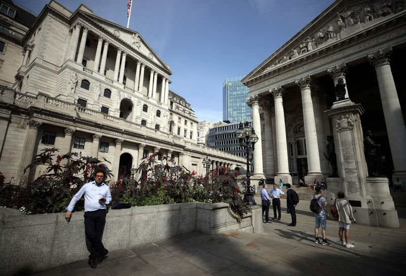 A person stands outside the Bank of England in London