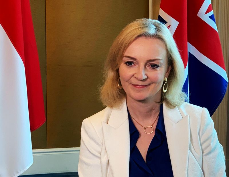 FILE PHOTO: British trade minister Liz Truss speaks to Reuters after signing a free trade agreement with Singapore, in Singapore