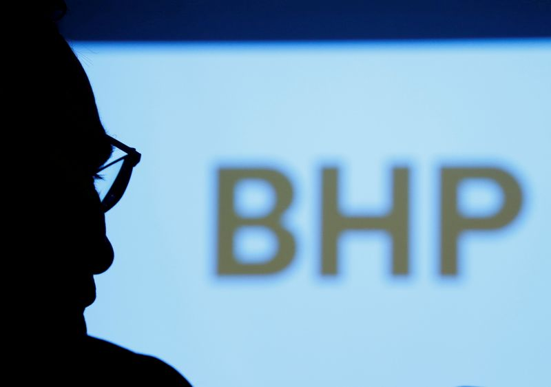 FILE PHOTO: BHP's logo is projected on a screen during a round-table meeting with journalists