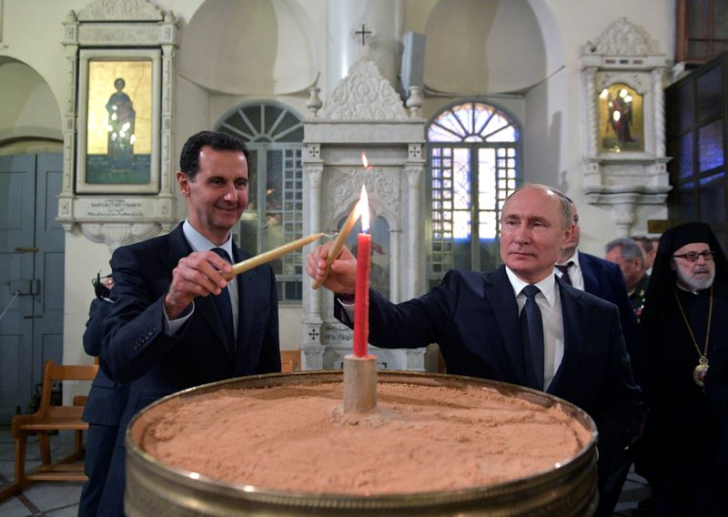 FILE PHOTO: Russian President Putin meets with his Syrian counterpart Assad in Damascus