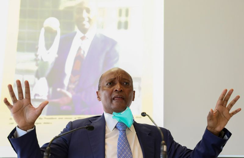 FILE PHOTO: South African billionaire Patrice Motsepe gestures during a media briefing