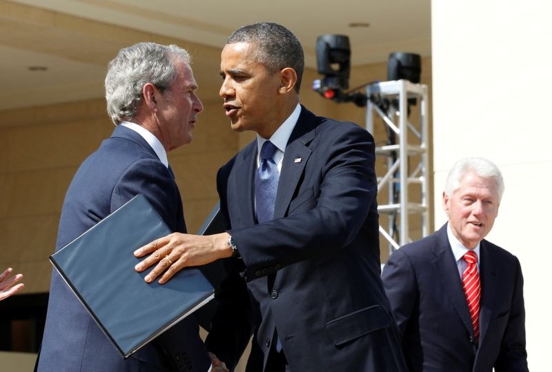 FILE PHOTO: U.S. President Barack Obama embraces George W. Bush following remarks at the dedication ceremony of the George W. Bush Presidential Center in Dallas