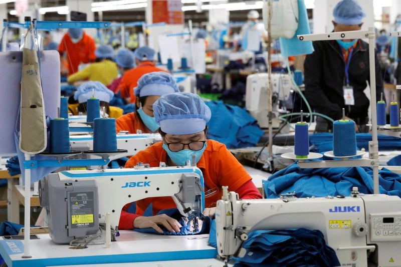 FILE PHOTO: The making garment products for export at a factory in Hung Yen province