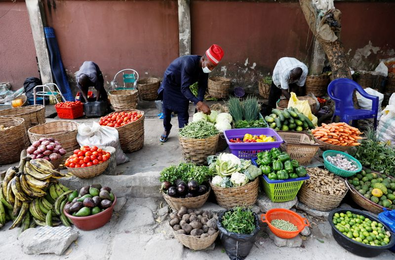FILE PHOTO: Vendors sell vegetables at a street market in Victoria Island, in Lagos