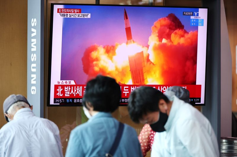People watch TV broadcast file footage of a news report showing what appeared to be a pair of ballistic missiles fired by North Korea off its east coast in Seoul