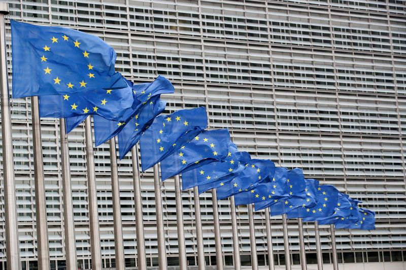 Flags flutter outside EU Commission in Brussels