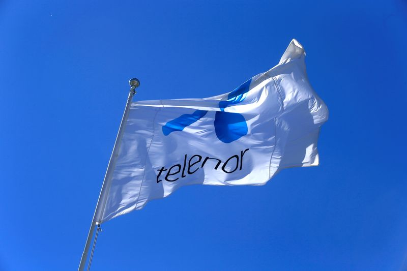 FILE PHOTO: FILE PHOTO: Telenor flag flutters next to the company's headquarters in Fornebu