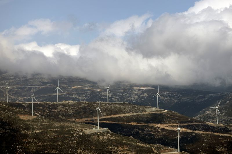 FILE PHOTO: Wind turbines are seen on a mountain near the town of Karystos, on the island of Evia