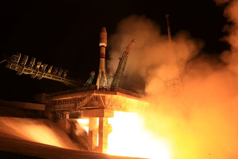 A rocket booster with satellites of British firm OneWeb blasts off from a launchpad at the Baikonur Cosmodrome