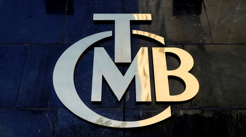 FILE PHOTO: A logo of Turkey's Central Bank is pictured at the entrance of the bank's headquarters in Ankara