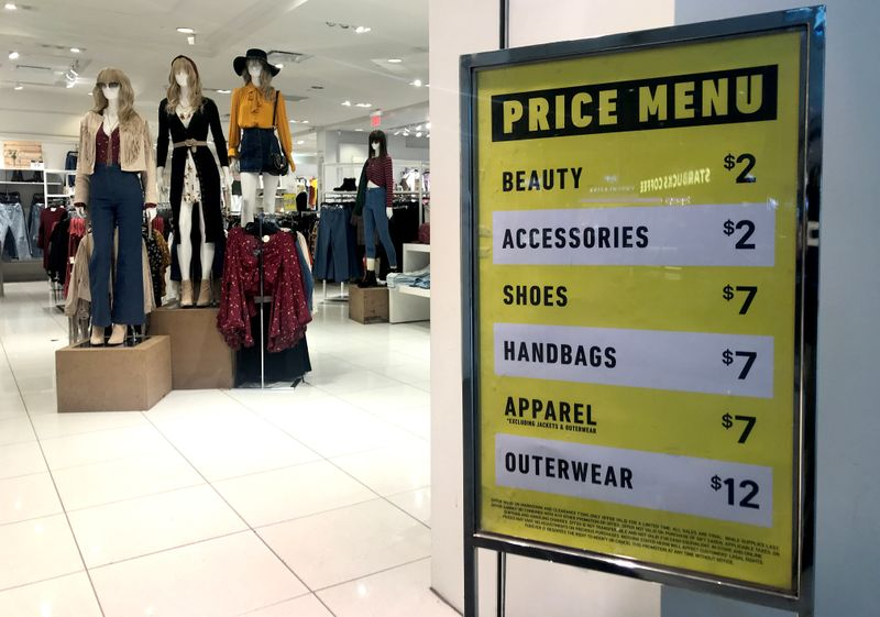 FILE PHOTO: Sales on clothing and shoes are advertised at the entrance to a Forever 21 fashion retail store in downtown Toronto