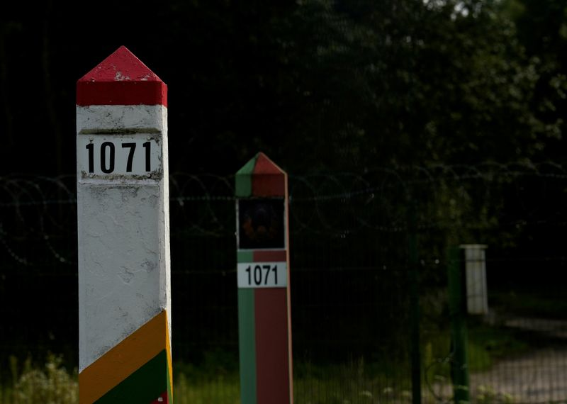 FILE PHOTO: Lithuanian and Belarus border marks are seen on the Belarus-Lithuania border in Medininkai