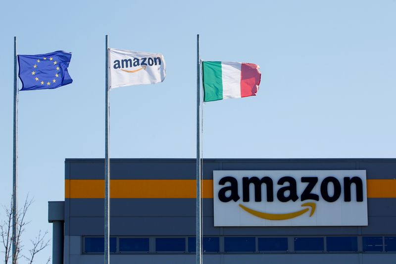 FILE PHOTO: Flags flutter outside a distribution centre, during a strike at Amazon's logistics operations in Itally