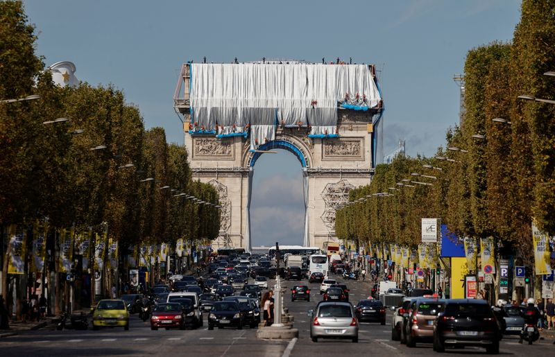 Arc de Triomphe enveloped by a shimmering wrapper in a posthumous installation by artist Christo