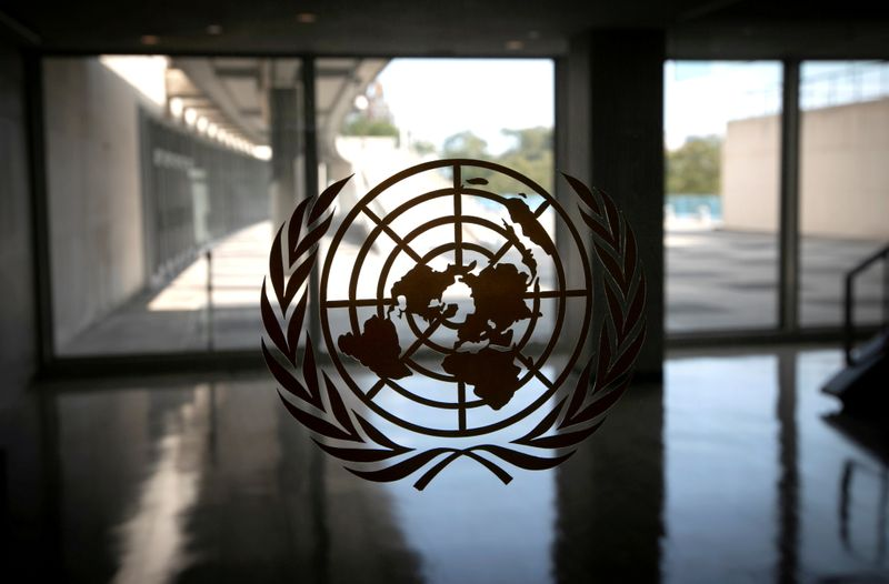 FILE PHOTO: The United Nations logo is seen on a window in an empty hallway at United Nations headquarters