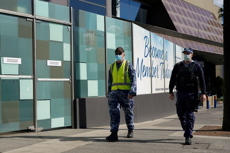 FILE PHOTO: Personnel from the Australian Defence Force and New South Wales Police Force patrol a street in Sydney's Bankstown suburb during an outbreak of the coronavirus disease