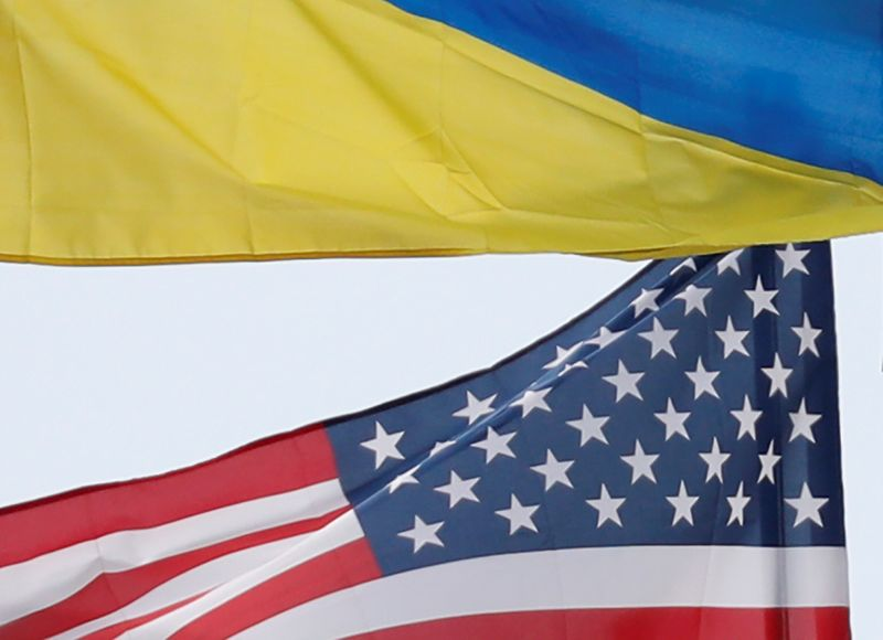 Ukrainian and U.S. state flags fly in Kiev
