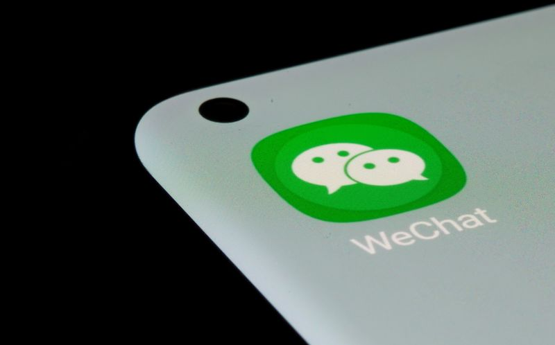 WeChat app is seen on a smartphone in this illustration taken