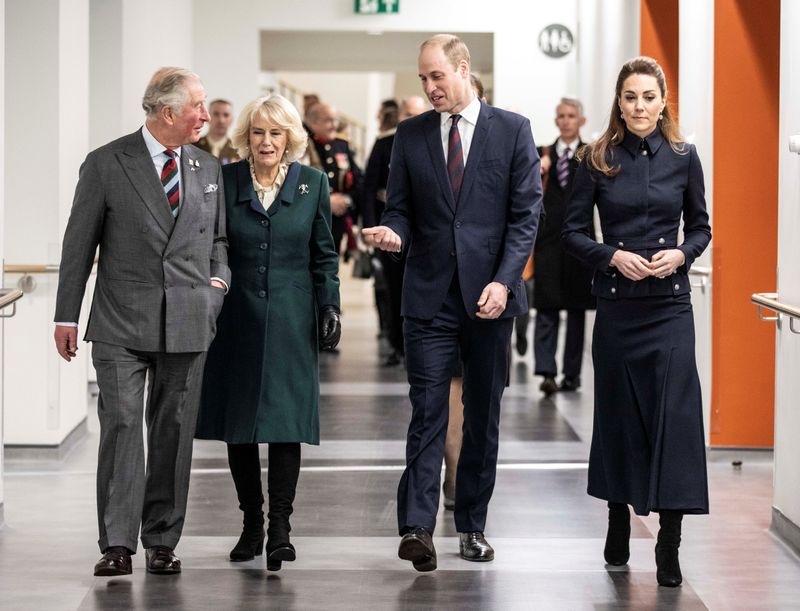 Britain's Prince Charles and Camilla, Duchess of Cornwall and Britain's Prince William, and Catherine, Duchess of Cambridge are seen during a joint visit to the Defence Medical Rehabilitation Centre (DMRC) in Nottinghamshire