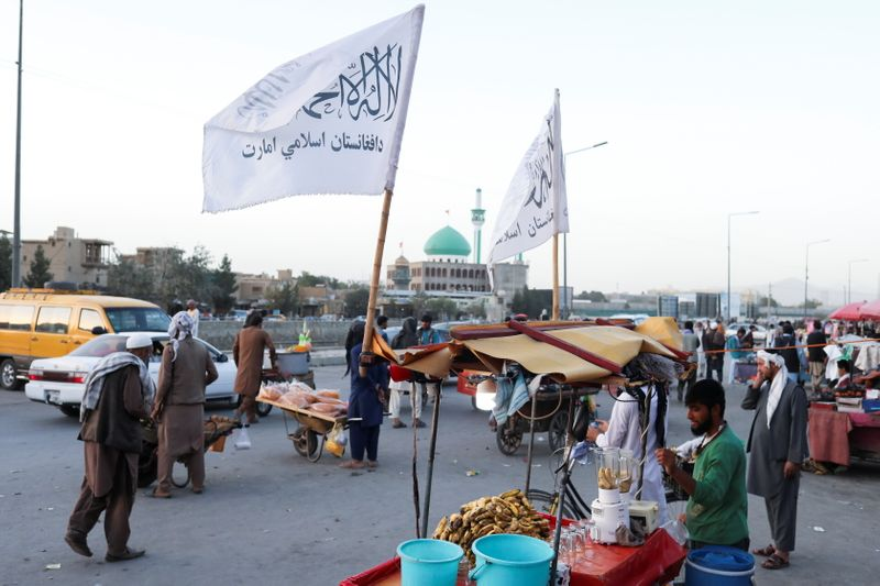 The Taliban flags are seen on a street in Kabul