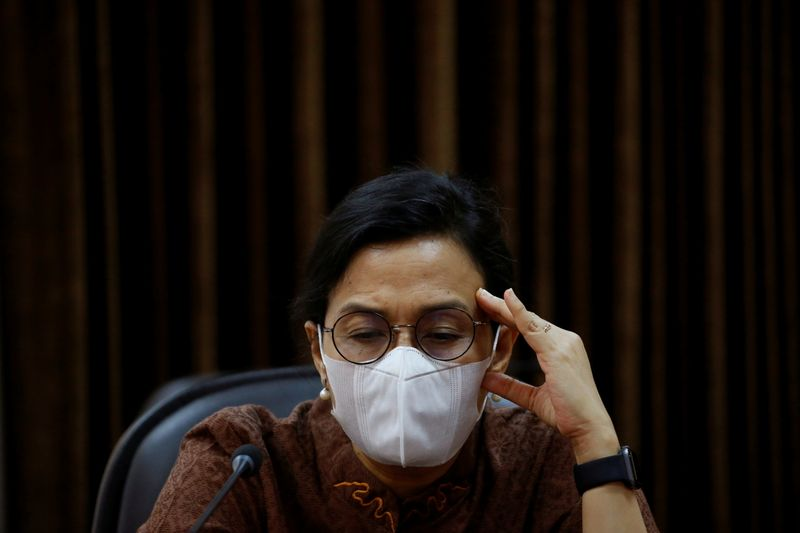 FILE PHOTO: Indonesian Finance Minister Sri Mulyani wearing a protective mask reacts during an interview with Reuters at the Presidential Palace in Jakarta