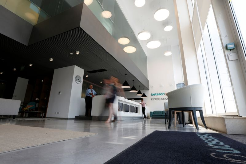 FILE PHOTO: Betsson Group employees walk through the reception lobby of the Betsson headquarters in Ta' Xbiex