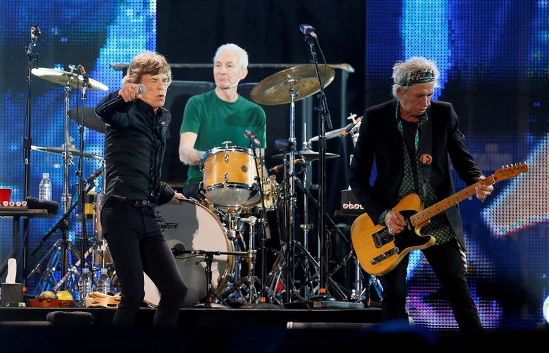 FILE PHOTO: Mick Jagger, Charlie Watts and Keith Richards of the Rolling Stones perform during a concert in Abu Dhabi