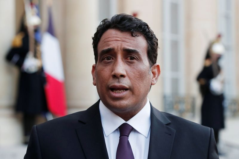 Mohamed al-Menfi, Head of the Presidential Council of Libya, talks to the press after a meeting with the French President at the Elysee Palace in Paris