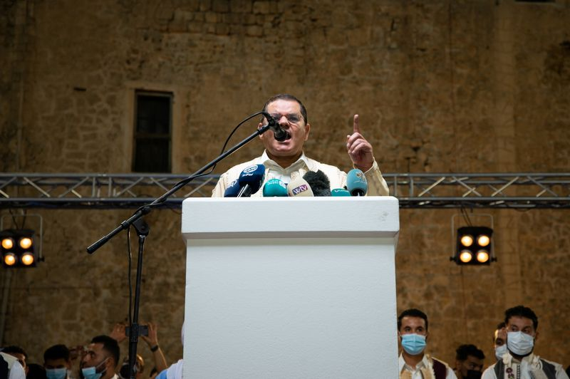 Libyan Prime Minister Abdulhamid Dbeibah speaks during a protest against the eastern-based House of Representatives, in Tripoli